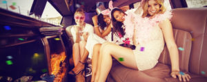 Girls sitting in the limousine and using tracy limo service