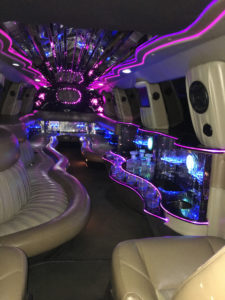 Modesto Limo service interior pink and blue light very colorful.